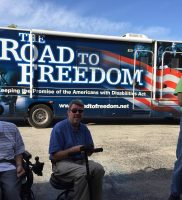 Larry Biondi and Clark Craig in front of the ADA Legacy Bus, with bus driver Tom Olin