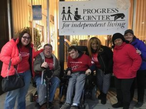 Image of members of the Progress Center Community outside of Progress Center's Office in Forest Park