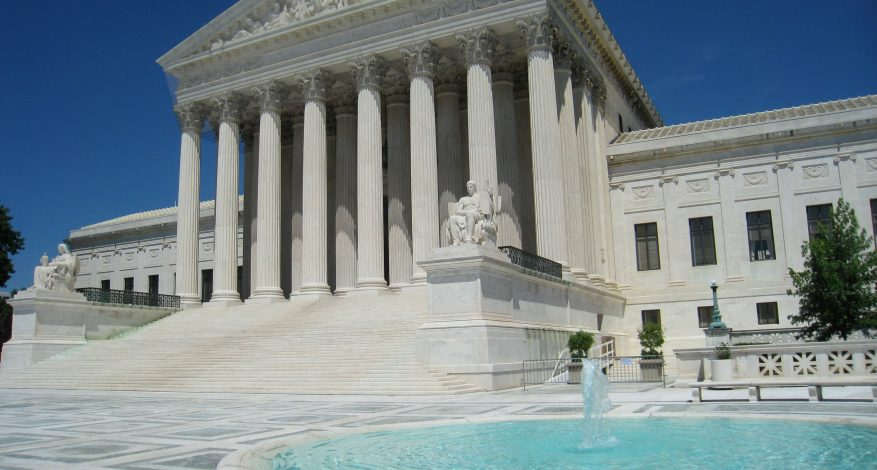Image of Supreme Court Building in Washington DC and a fountain outside the building