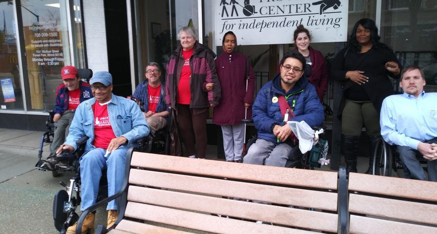 A group of Progress Center Community Members on Madison in Forest Park, outside the Progress Center Office