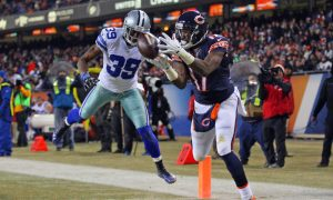 image from a Bears Cowboys Game in 2014. Bears receiver appears to be catching ball in end zone while defended by Cowboy player