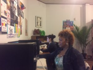 image of two people working on computers in an office